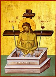 Extreme Humility: Christ with his hands bound voluntarily, a cross behind him, partially in a grave