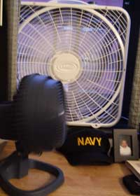 fans in window and bedside junk